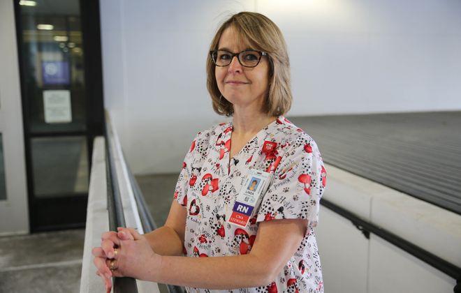 Registered Nurse Linda Sheehan wears a colorful uniform.  (Derek Gee/Buffalo News)