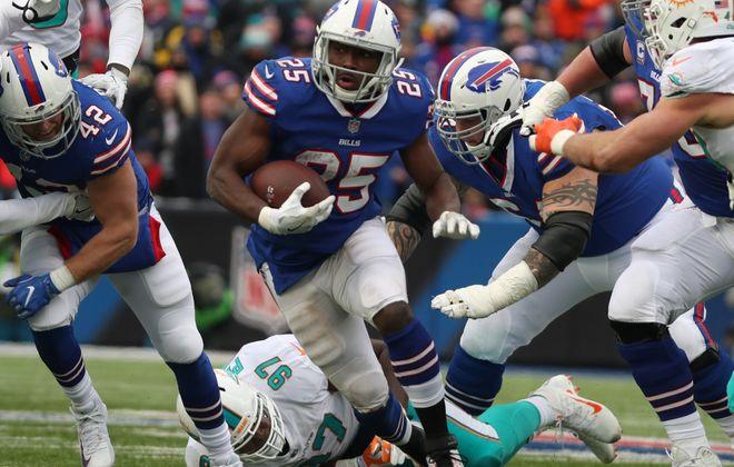 Buffalo Bills running back LeSean McCoy shoots a gap in the Miami defense. (James P. McCoy/News file photo)