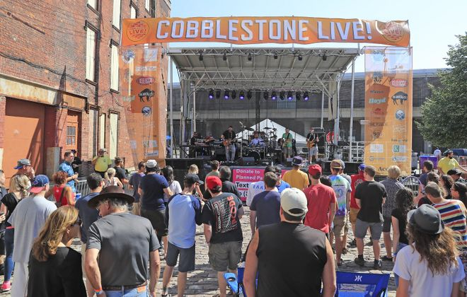 Music fans watch the action on the main stage at the first Cobblestone Live in 2017. (Harry Scull Jr./News file photo)