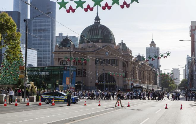 """Police block off Flinders Street after a vehicle rammed into a crowd on the corner of Elizabeth and Flinders Streets in Melbourne, Australia, Dec. 21, 2017. The driver of the SUV who plowed into a crowd on the busy street on Thursday, injuring at least 19 people, was mentally ill, Australian officials said, describing the attack as a deliberate """"act of evil"""" but not terrorism. (Asanka Brendon Ratnayake/New York Times)"""