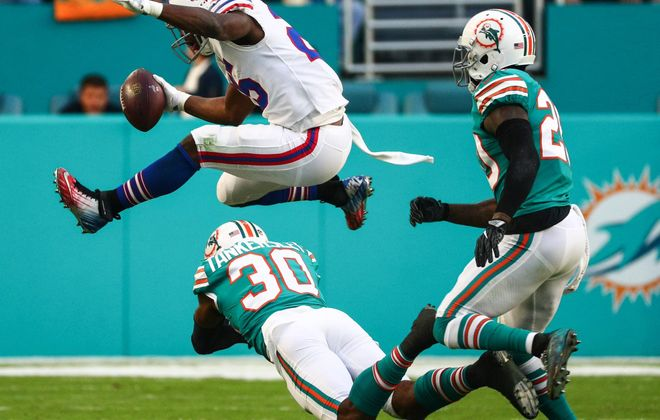 LeSean McCoy leaps over a would-be Dolphins tackler in a December 2017 game. (James P. McCoy/Buffalo News)