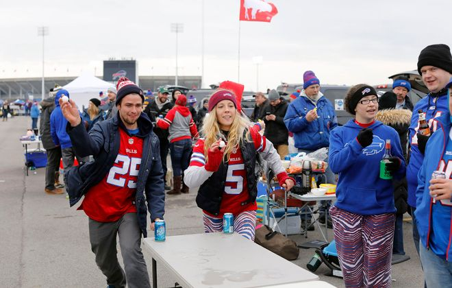 Bills fans play beer pong in the parking lot before the game at New Era Field in Orchard Park on a sunny November game day.  (Derek Gee/News file photo)