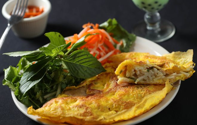 Pho Golden's banh xeo appetizer is a Vietnamese pancake with sliced pork and shrimp served with fish sauce. (Sharon Cantillon/News file photo)