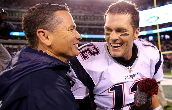 Tom Brady of the New England Patriots celebrates with trainer Alex Guerrero after defeating the New York Jets in a 2016 game. (Getty Images)