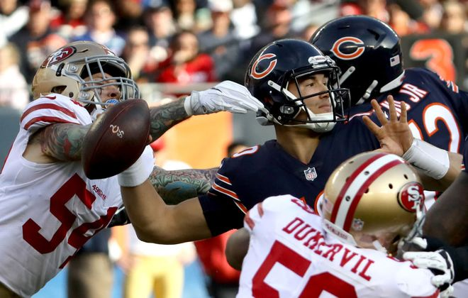 Cassius Marsh (54) of the San Francisco 49ers reaches for quarterback  Mitchell Trubisky of the Chicago Bears in the third quarter at Soldier Field on Dec. 3, 2017, in Chicago. The Bears lost to the Niners, 15-14.  (Jonathan Daniel/Getty Images)