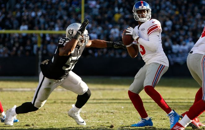 The Raiders' Khalil Mack forced a fumble that he then recovered against the Giants and quarterback Geno Smith on Sunday. (Getty Images)