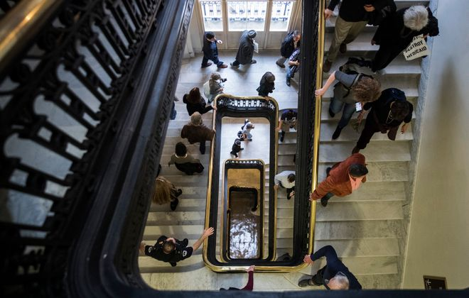 Activists rallying against the GOP tax reform bill make their way through the Cannon House Office building on Capitol Hill on Dec. 5, 2017, in Washington, D.C. (Getty Images)