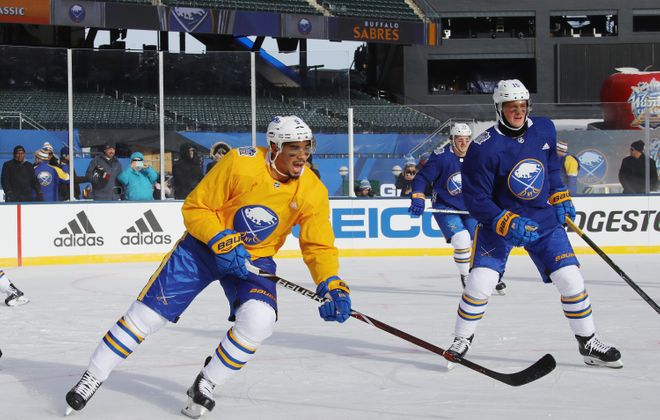 Evander Kane (in gold) made a fashion statement with his eye black during a sunny practice Sunday. (Getty Images)