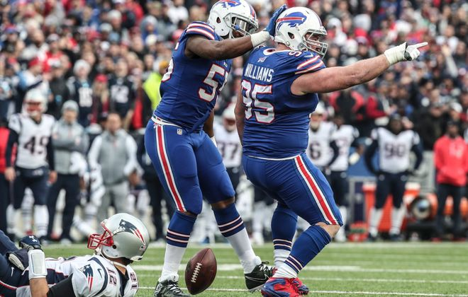 Buffalo Bills defensive tackle Kyle Williams (95) sacks New England Patriots quarterback Tom Brady (12) in the second quarter at New Era Field in Orchard Park on Sunday, Dec. 3, 2017. (James P. McCoy/Buffalo News)