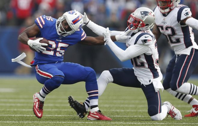 Buffalo Bills' LeSean McCoy gets away from New England Patriots' Devin McCourty in the first quarter. (Mark Mulville/Buffalo News)