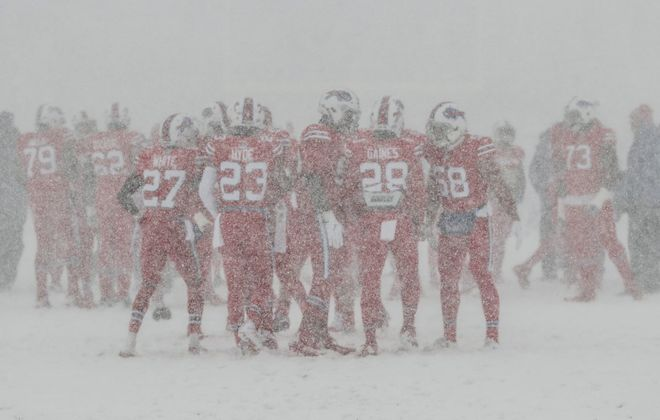 Snow pelts the Bills during warmups before their game against the Colts at New Era Field in Orchard Park, N.Y. on Dec. 10, 2017 (James P. McCoy/Buffalo News)