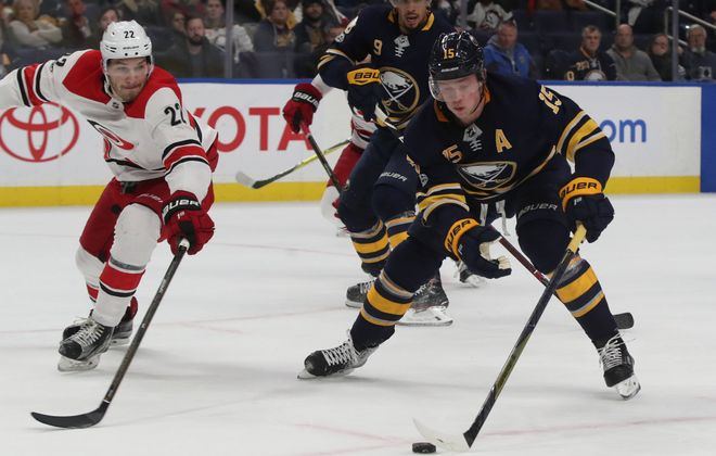 The Sabres' Jack Eichel (15), joined by Evander Kane to challenge Carolina's Brett Pesce, recorded his first career hat trick. (James P. McCoy/Buffalo News)