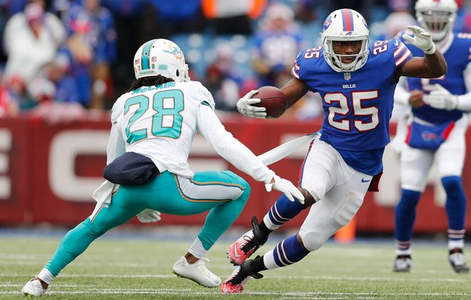 Buffalo Bills' LeSean McCoy puts a move on Miami Dolphins' Bobby McCain in the first quarter. (Mark Mulville/Buffalo News)