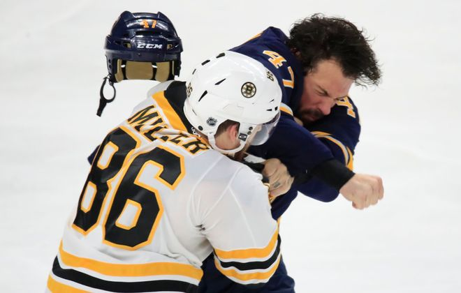 Boston's Kevan Miller and the Sabres' Zach Bogosian set a physical tone just 4:48 into the game Tuesday. (Harry Scull Jr./Buffalo News)