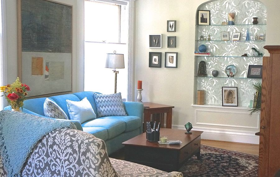 In the redecorated living room, the recessed area provides a focal point. (Photos courtesy Donna Evans-Deyermond )
