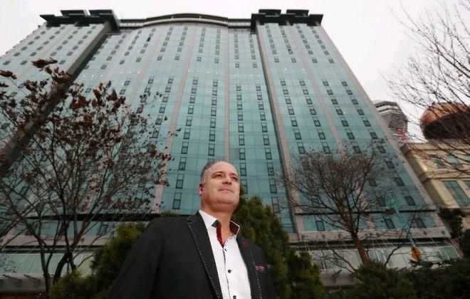Michael DiCienzo of Canadian Niagara Hotels in front of the Sheraton on Falls Avenue in Niagara Falls, Ont. (Sharon Cantillon/Buffalo News)