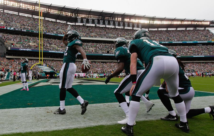 Torrey Smith of the Philadelphia Eagles celebrates running the ball 59 yards for a touchdown against the Arizona Cardinals with a baseball skit. (Getty Images)