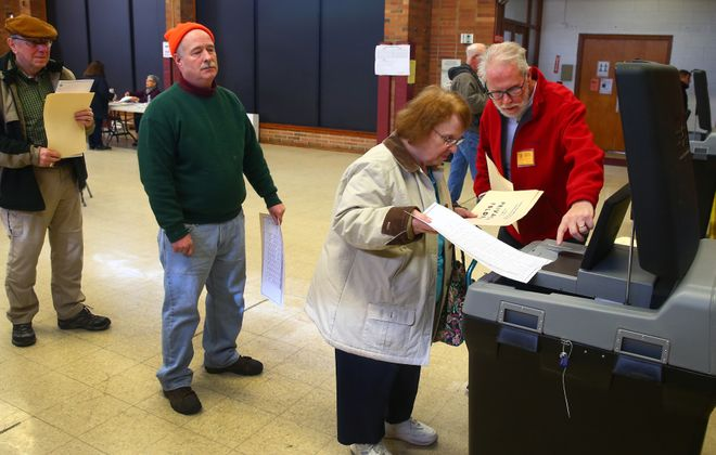Election Inspector Ken Tunnah, right, helps Lucille Melton cast her ballot on Election Day at Trinity United Methodist Church, in Amherst, N.Y. on Nov. 7, 2017.  (John Hickey/Buffalo News)