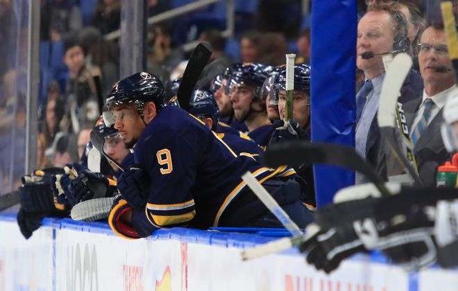 Evander Kane and the rest of the Sabres bench are stunned as they watch the team's third straight shutout (Harry Scull Jr./Buffalo News).