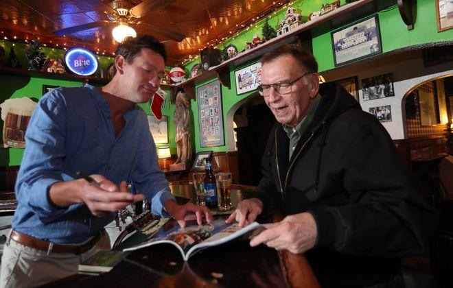 Owner Kevin Hoak, left, talks with customer John Langan of Hamburg.  (Sharon Cantillon/Buffalo News)
