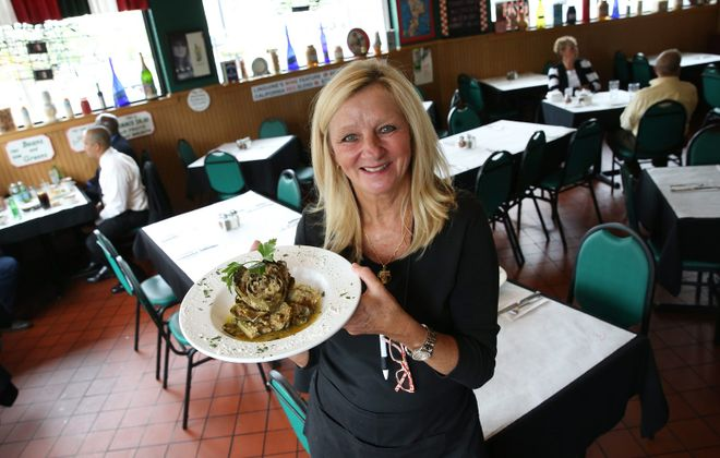 Linguine's owner Linda Desiderio, who's looking forward to reopening her restaurant with husband Vincent, presents the stuffed artichoke, in 2015.  (Sharon Cantillon/News file photo)