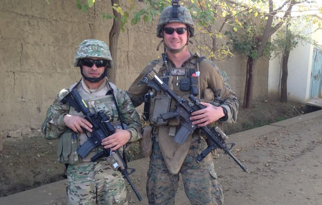 """Marine Capt. Maurice L. """"Chipp"""" Naylon IV, right, patrols in Afghanistan with a Republic of Georgia officer. Building rapport with the Georgians before they headed to Afghanistan was the key to success, he said."""