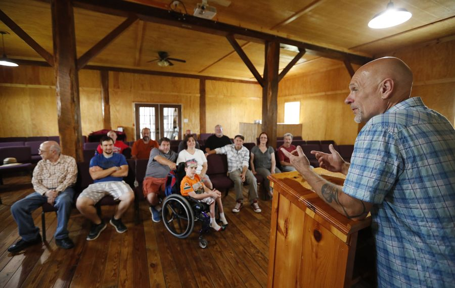 """A lot of the curriculum at the Total Freedom Farm addictions treatment program """"has to do with healing and strengthening,"""" says leader John Kula, a pastor who has struggled with drug abuse himself. (Mark Mulville/Buffalo News)"""
