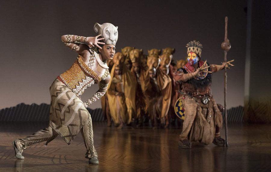 "Nia Holloway, left, plays Nala and Buyi Zama  plays Rafiki (with staff) in the touring production of ""The Lion King"" at Shea's Performing Arts Center."
