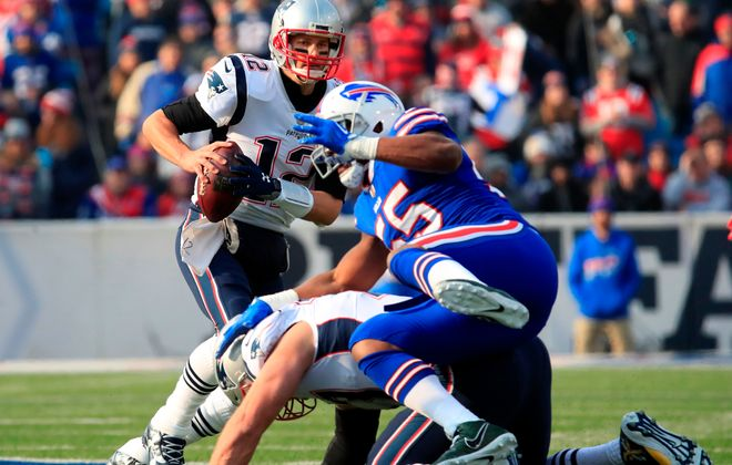 New England Patriots quarterback Tom Brady scrambles against the Buffalo Bills during first quarter action at New Era Field on Sunday, Dec. 3, 2017. (Harry Scull Jr./ Buffalo News)
