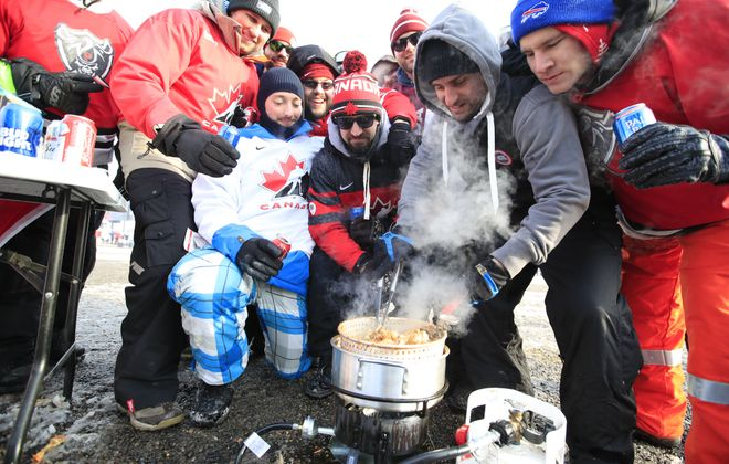 Canadian fans cook chicken wings during a tailgate prior to the World Junior hockey game between the USA and Canada at New Era Field on Friday, Dec. 29, 2017. (Harry Scull Jr./ Buffalo News)