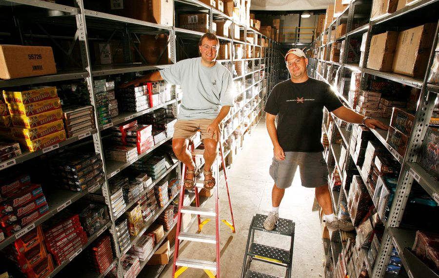 Adam  Martin and  David Silver hang out in their warehouse. (James P. McCoy/Buffalo News)