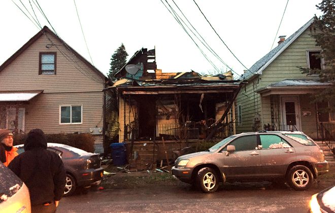 What's left of 73 Peter St. in Black Rock after an early-morning fire. Four cats died, but the two residents were able to escape with their dog. Homes on each side damaged. (Aaron Besecker/Buffalo News)