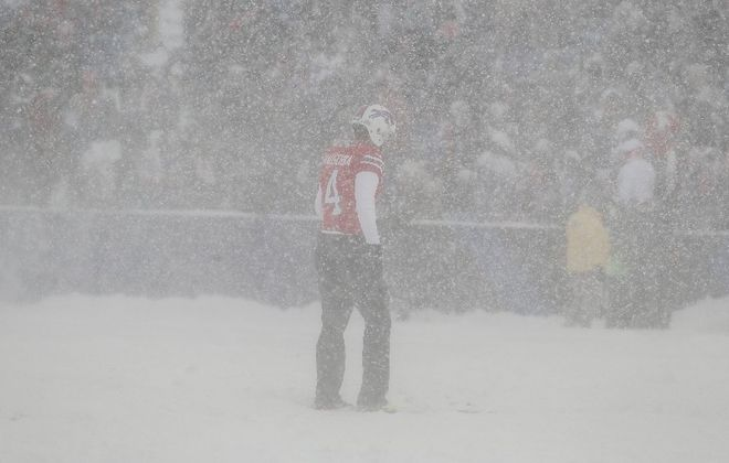 Stephen Hauschka heads out to warm up in the snow (James P. McCoy/Buffalo News)