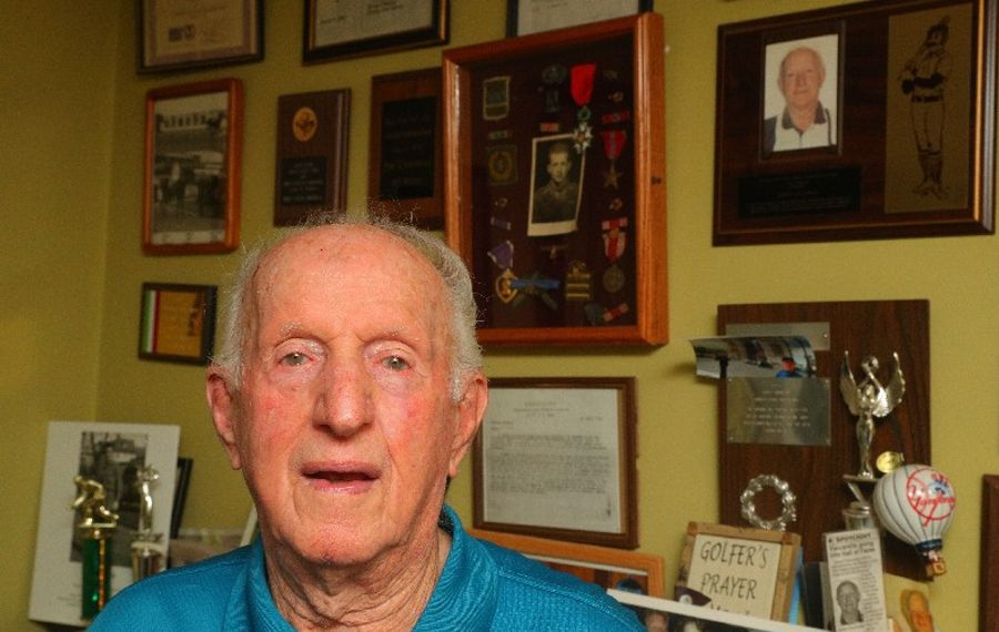 World War II Army medic James V. Vaccarella turned down officers training to avoid being sent to the front lines, but ended up there anyway where he earned a Purple Heart while treating wounded soldiers. (John Hickey/Buffalo News)