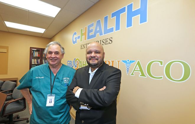 Chet Fox, chief medical officer, left, and Raul Vazquez, president and CEO at the new G-Health Enterprises clinic that has recently opened on Jefferson Avenue. (Robert Kirkham/Buffalo News)