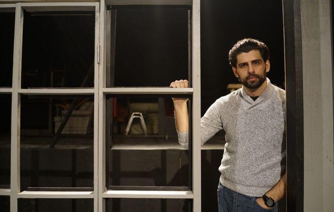 "Brooklyn-based actor Afrim Gjonbalaj stars in Road Less Traveled Theatre's production of ""Disgraced,"" a Pulitzer-winning play that explores Muslim identity in America by Ayad Ahktar. (Derek Gee/Buffalo News)"