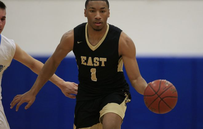 Willard Anderson and the East boys basketball team will have to wait until Saturday to face Franklinville for the Section VI Class D championship due to winter weather. (Harry Scull Jr./Buffalo News)
