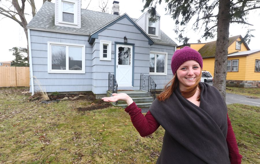 """Vanessa Krnjaich, 26, put a lot of sweat equity into the long-vacant home she bought on Rose Avenue in West Seneca for $45,555 at auction. """"It needed a lot of love,"""" she says. (John Hickey/Buffalo News)"""