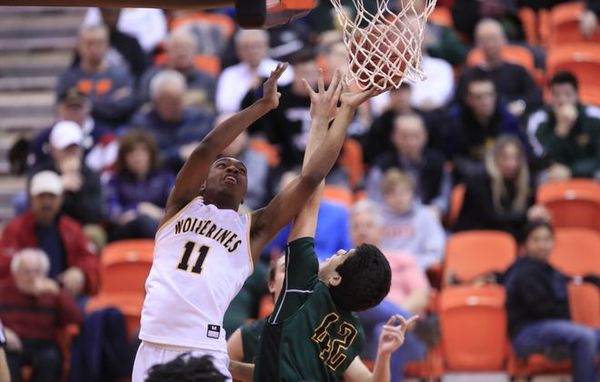 Niagara Falls Syquan Ralands shoots over Williamsville North's Joe Nusall. (Harry Scull Jr./ Buffalo News)