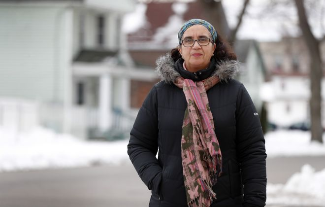 """The city is offering for sale vacant lots scattered in the southern and eastern portions of the Fruit Belt. """"We first need to make sure we're picking out the right clusters and have to survey the land,"""" said Grape Street resident Dennice Barr.  (Mark Mulville/Buffalo News)"""