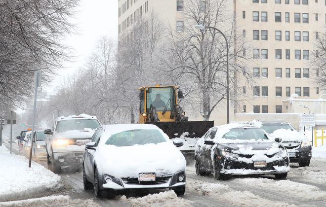 Messy winter storms can have an affect on car warning systems. (Buffalo News file photo)