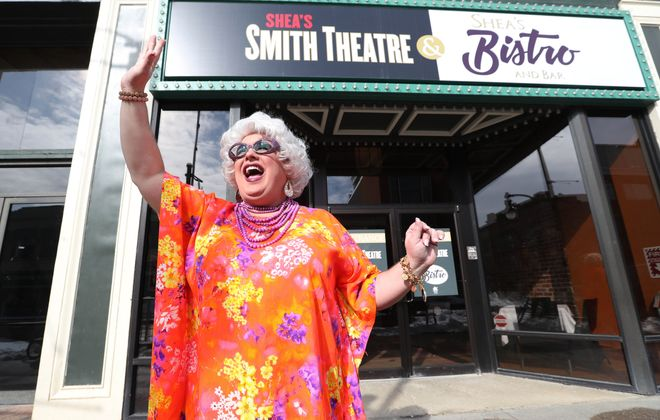 """Betsy Carmichael, a character created by Buffalo performer Joey Bucheker, waves to passers-by in front of Shea's Smith Theatre, where """"Betsy Carmichael's Bingo Palace"""" runs March 23 to 25. (Sharon Cantillon/Buffalo News)"""