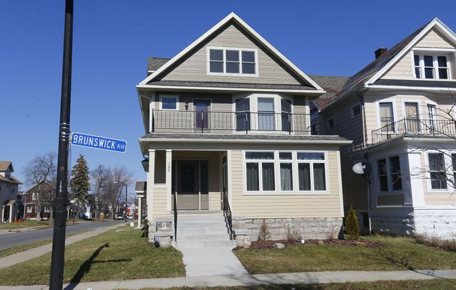 A house on Brunswick Boulevard in Hamlin Park  was a neighborhood concern for almost two decades. The city spent $560,000 in federal funds to rehab the house. Afterward, the house sold for $115,000. (Mark Mulville/News file photo)