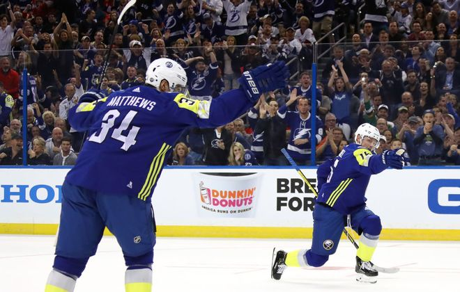 Auston Matthews, left, and Jack Eichel made their point after Eichel's goal at the All-Star Game in Tampa. (Getty Images)