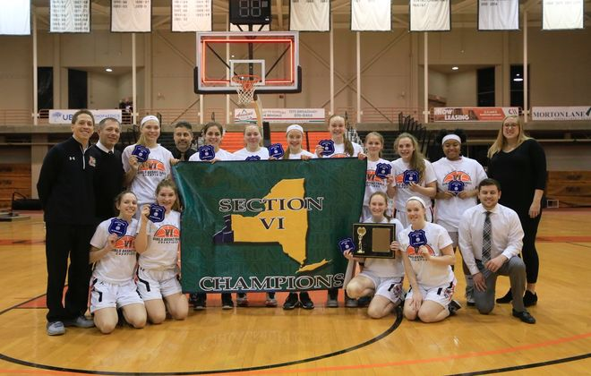 The Amherst girls basketball team celebrates its second straight Class A-2 championship. (Harry Scull Jr./Buffalo News)