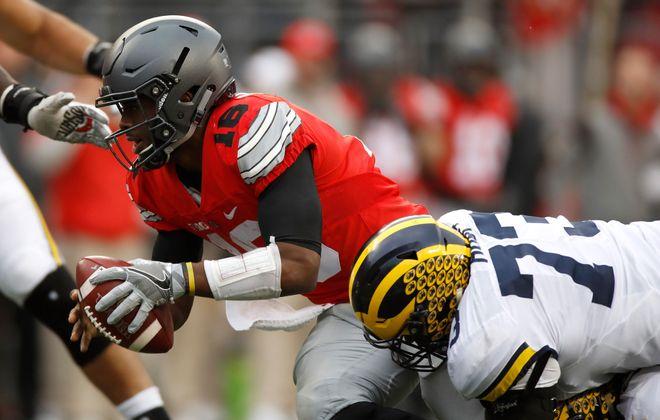 Michigan's Maurice Hurst sacks Ohio State's J.T. Barrett (Photo Gregory Shamus/Getty Images)