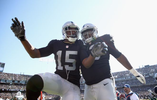 Michael Crabtree (left) celebrates with Marshall Newhouse (Ezra Shaw/Getty Images)