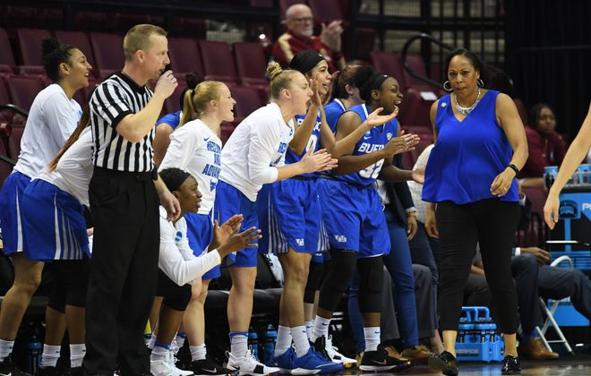 The UB bench reacts in front of coach Felisha Jegette-Jack during their first-round rout victory in the NCAA Tournament. (Phil Kelly/University at Buffalo)