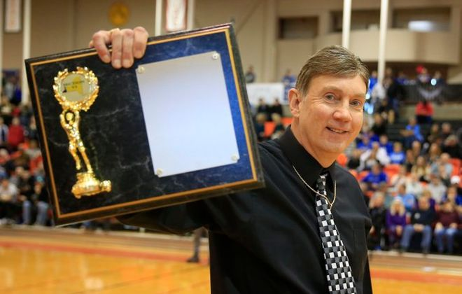 Jeff Anastasia shows off the Section VI Class B-1 championship Olean captured by defeating Newfane on Saturday at the Buffalo State Sports Arena. (Harry Scull Jr./Buffalo News)