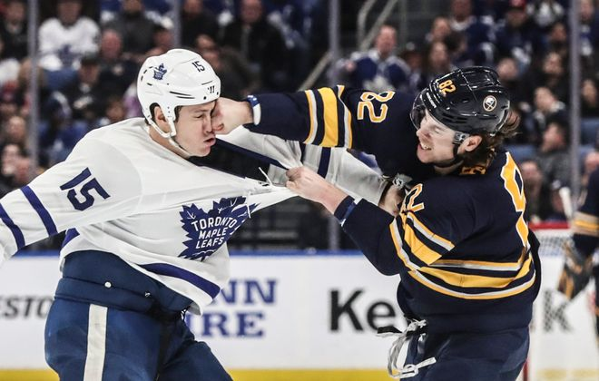 The Sabres' Nathan Beaulieu lands one of his many punches square on the face of Toronto's Matt Martin. (James P. McCoy/Buffalo News)